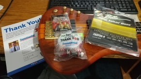 Here are the Dunlop strap locks, the La Bella strings and a bag of candy from Sweetwater.